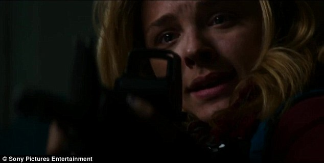 Sniper rifle: Moretz is no stranger to physical roles having taken action in flicks like Kick-Ass, Hugo, Let Me In, and The Equalizer