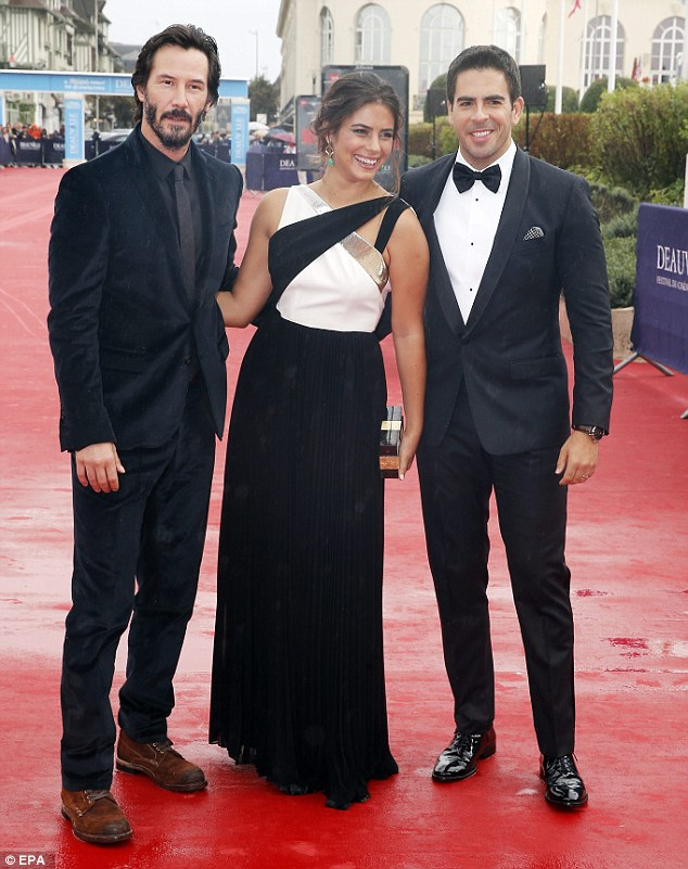 Talent on display: Keanu poses with Director Eli Roth and co-star Lorenza Izzo