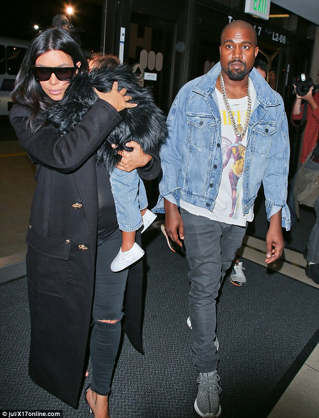 Nap time: Kim Kardashian and Kanye West arrived into LAX on Saturday night with a slumbering North