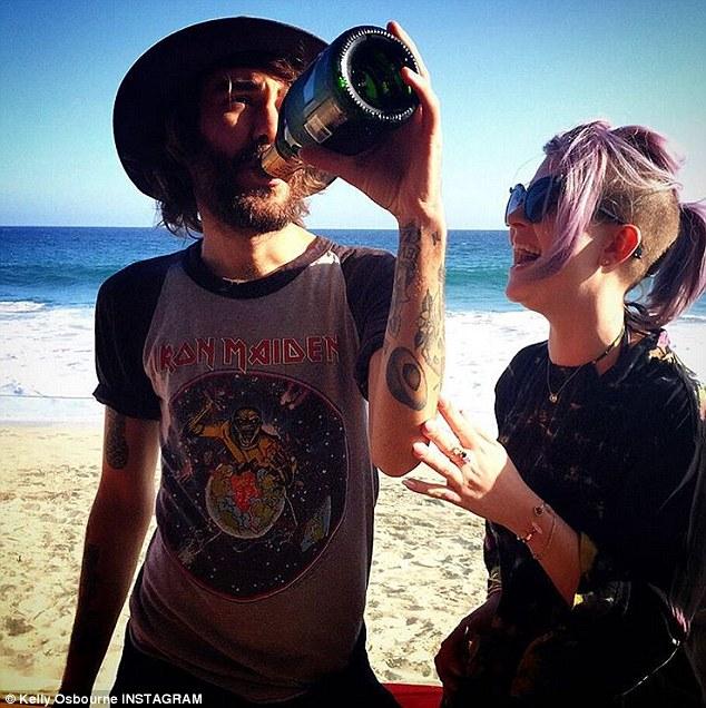 Moderation: Friend Cheyne Thomas knocked back some champagne while visiting Osbourne in Malibu