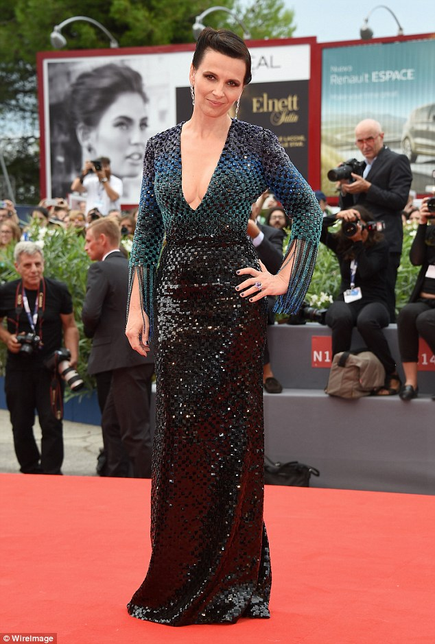 Smoking: Adding to her red carpet look with a pair of drop down silver earrings and a purple stoned ring, the actress drew attention to her purple painted nails by placing her hand on her hip