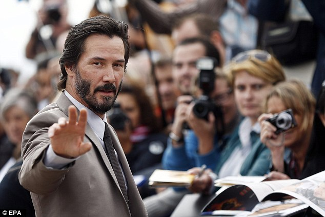 Man of the people: Keanu did not fail to live up to the expectations of the assembled crowd, who enthusiastically waited for the star to sign autographs