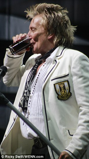 Thirsty work: Rod ensured he kept hydrated throughout the gig
