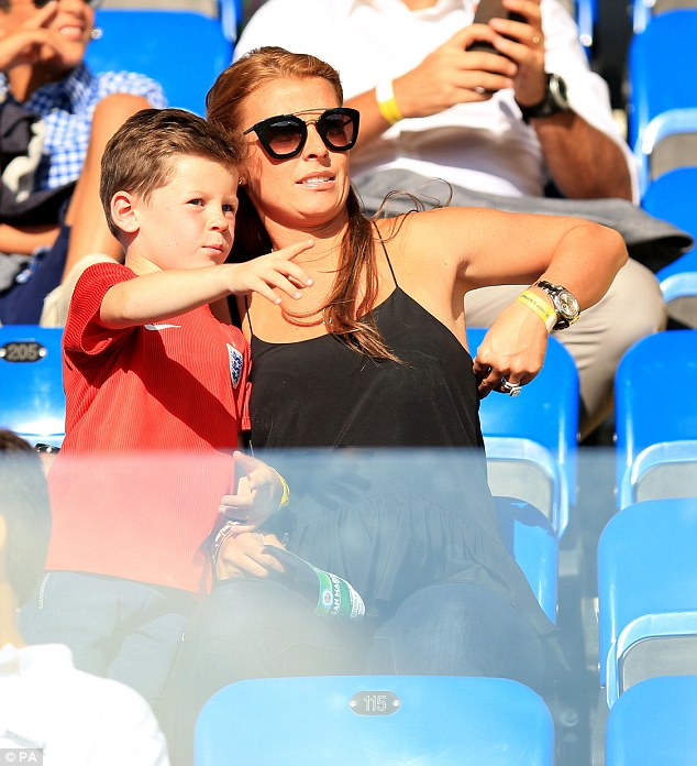 Looking out for daddy: Kai pointed to the pitch, showing his mum where Wayne could be seen