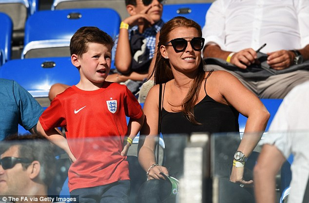 Footy know-it-all: Standing in an England T-shirt, the five-year-old looked like he knew all about the match