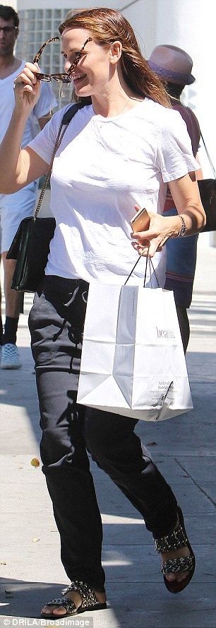 Success: Jen was seen with at least one shopping bag on Saturday