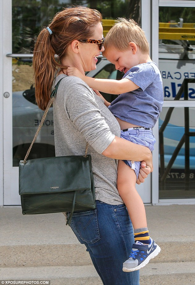 Mommy and me: Jennifer looked happy as she shared a laugh with three-year-old Samuel on an outing in Pacific Palisades on Friday