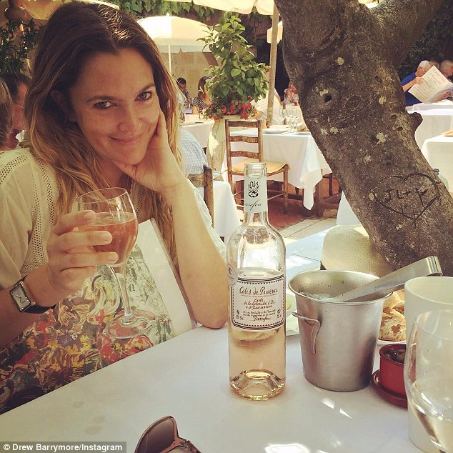 Toast to the good life! The mother-of-two Instagrammed a photo of herself tucking into a glass of rosé during her travels on Wednesday