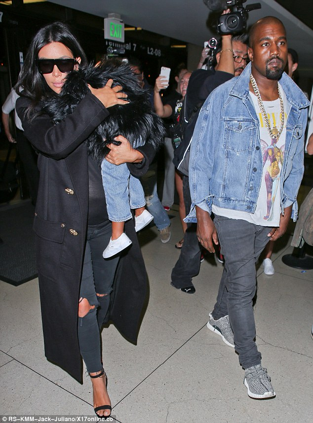 Trendy tot: Little Nori - as she's affectionately called - wore a little fur jacket and jeans for the trip