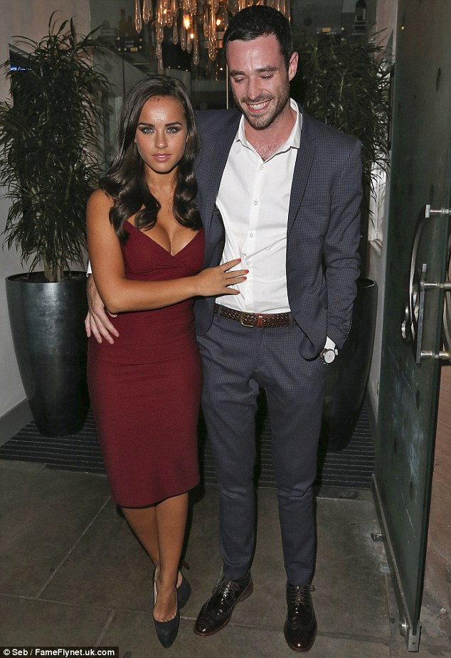 Good-looking couple: Georgia showcased her killer curves in a plunging pencil dress, and while she seemed to take their pre-meal  shoot quite seriously, her towering beau seemed to be in the mood for larking around