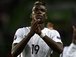 France's midfielder Paul Pogba (L) reacts after his victory against Portugal during the Euro 2016 friendly football match Portugal vs France at the Jose Alvalade stadium in Lisbon on September 4, 2015. France won 0-1.  AFP PHOTO/ FRANCK FIFEFRANCK FIFE/AFP/Getty Images