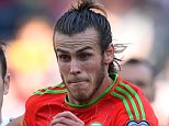 CARDIFF, WALES - SEPTEMBER 06:  Gareth Bale of Wales is closed down by Bibras Natkho (L) of Israel and Orel Ogani (R) of Israel during the UEFA EURO 2016 group B qualifying match between Wales and Israel at Cardiff City Stadium on September 6, 2015 in Cardiff, United Kingdom.  (Photo by Stu Forster/Getty Images)
