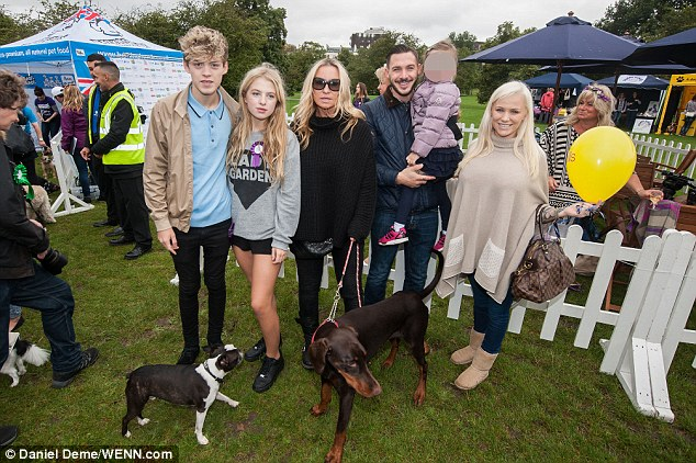 Unlikely friends: Kirk, Holli and little Scarlett were joined by Meg Matthews and her daughter Anais and her boyfriend Reece Bibby