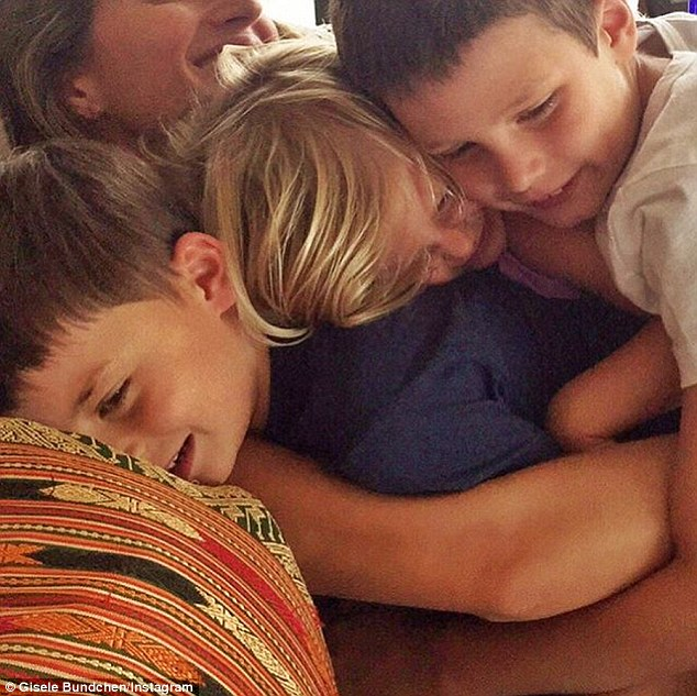 All in the family! Gisele celebrated her eldest stepson, John's latest milestone last week, captioning the huddled portrait: '8 years ago today a little angel was born'