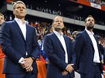 (L to R) Netherlands' assistant coach Marco Van Basten, head coach Danny Blind and assistant coach Ruud van Nistelrooy look on during the UEFA Euro 2016 qualifying round football match between Netherlands and Iceland at the Arena Stadium, on September 3, 2015 in Amsterdam. AFP PHOTO / JOHN THYSJOHN THYS/AFP/Getty Images