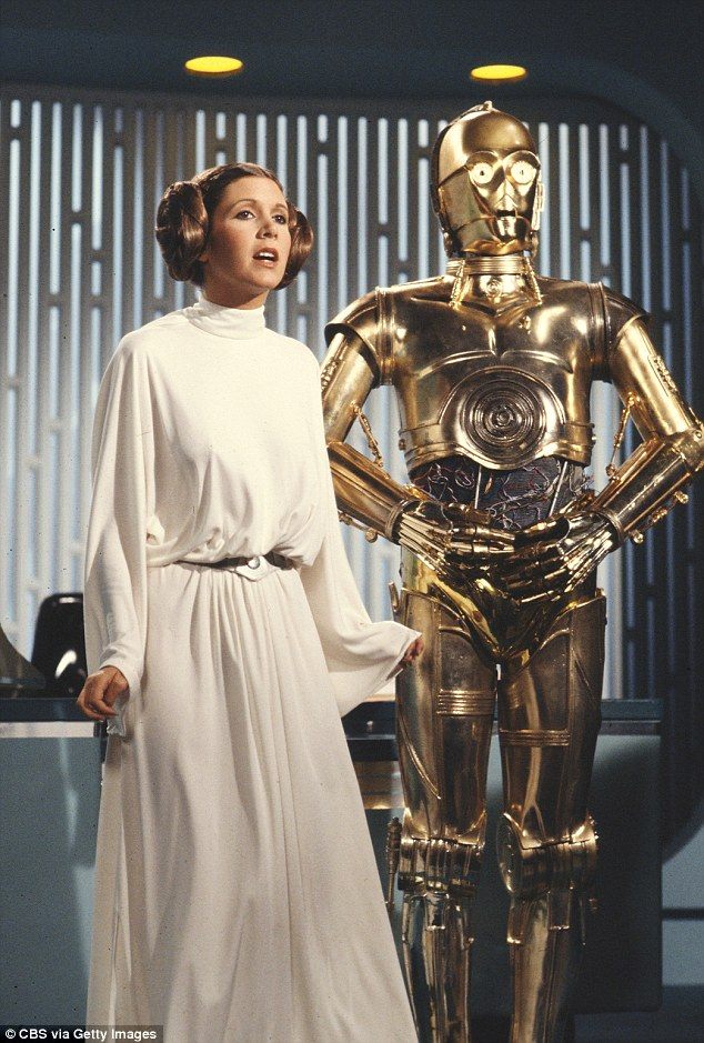 Better days: Anthony portrays C-3PO (R), pictured with Carrie Fisher (R) as Princess Leia
