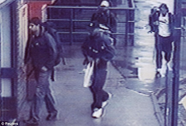 Outrage: The four terrorists enter Luton railway station carrying the bombs they made at the factory