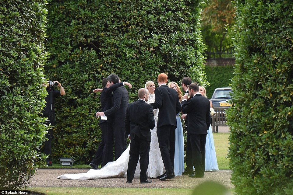 Congratulations: Guests sip champagne and congratulate the newlyweds on their special day after tying the know