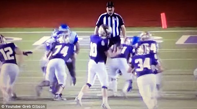 Two football players from John Jay High School have been suspended after tackling the referee from behind during a game against Marble Falls before diving into him on the floor
