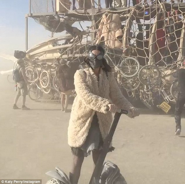 Whoops: Katy Perry had a laugh at her own expense on Sunday when she took a spill from her Segway at Burning Man