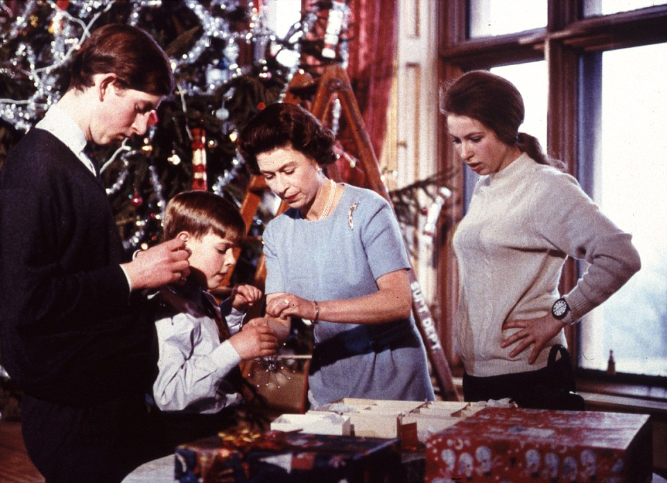 1969: The Queen helps her sons Prince Charles and Prince Andrew and daughter Princess Anne dress the Christmas tree at Windsor. The scenes were captured during a landmark documentary about the Queen called 'The Royal Family'