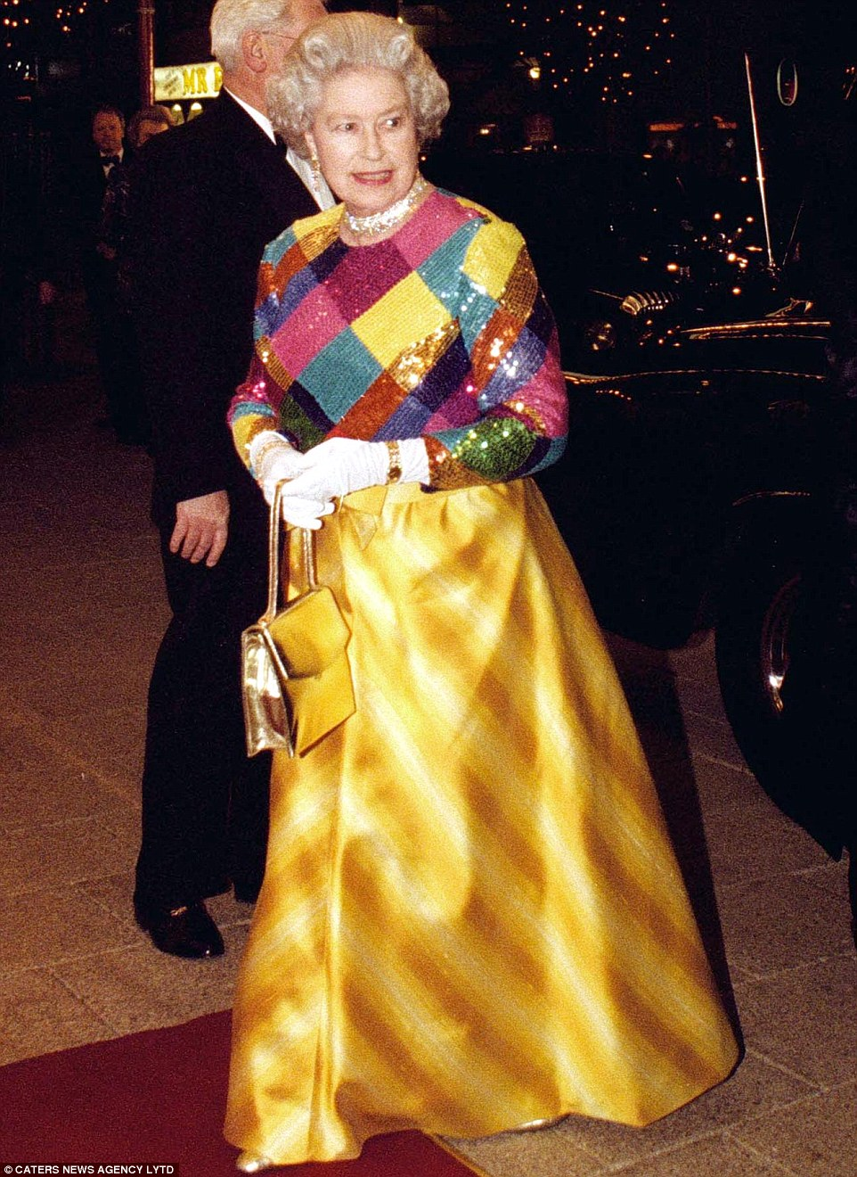 1999: The Queen raised eyebrows with a rare style disaster in a colourful dress while attending the Royal Variety Performance in 1999