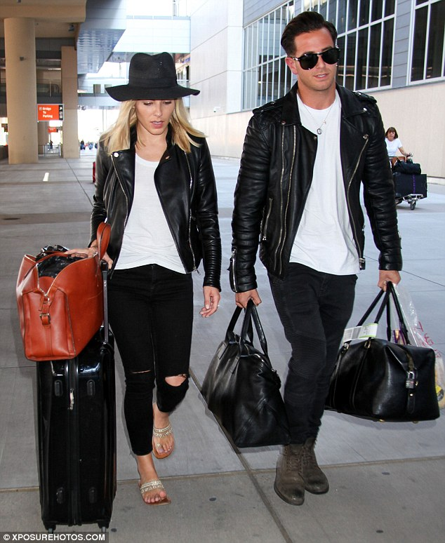 Biker babe: Clearly not above carrying her own luggage, Mollie wheeled her suitcase alongside a tan leather holdall as she negotiated her way out of the airport in the Nevada heat