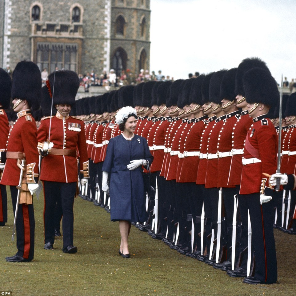 1964: The Queen carries out duties in her role as head of the armed forces by inspecting the 1st and 2nd Battalion Coldstream Guards at Windsor