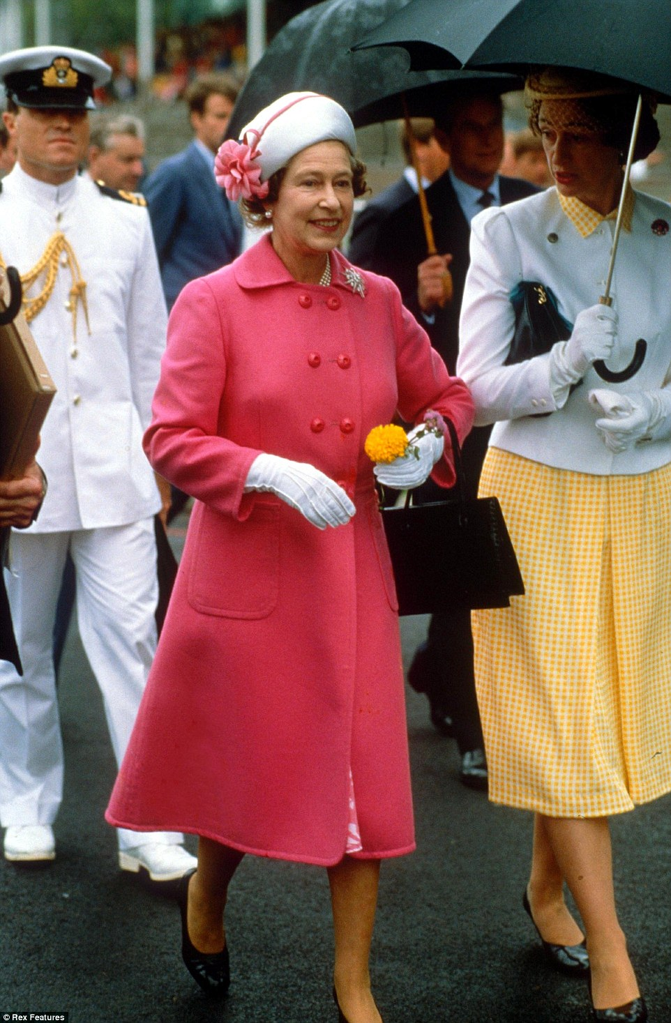 1986: Known for her love of bright colours, the Queen stands out in bright pink during a tour of New Zealand in 1986 with Prince Philip
