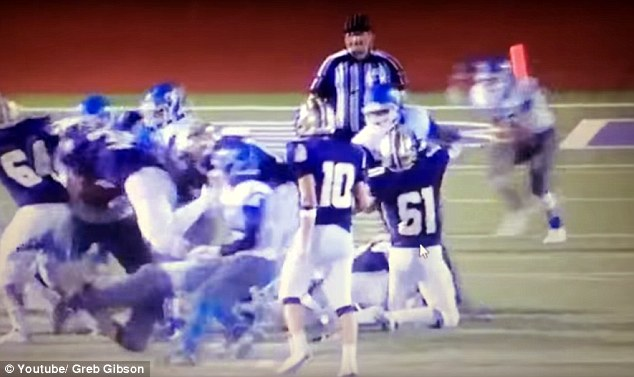 Footage of the attack, which has been described as 'extremely disturbing', shows one of the John Jay defensive backs running five yards into the referee (right)