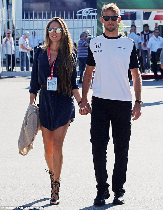 Strong bond: Moving on from their horrific robbery at their French holiday villa last month, the striking model looked positively radiant as she locked hands with her husband Jenson - who had finished in 14th place during the day's race