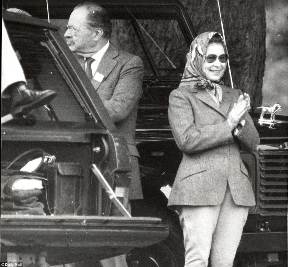 1988: Looking relaxed dressed in jodphurs, riding boots and a hacking jacket, the Queen applauds her husband in the driving ring at Royal Windsor Horse Show