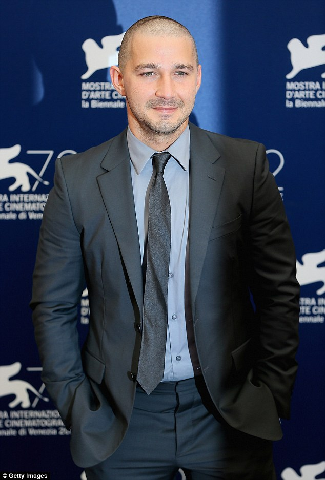 Sharp: Now the actor donned a dark grey suit, tie, and blue-grey shirt