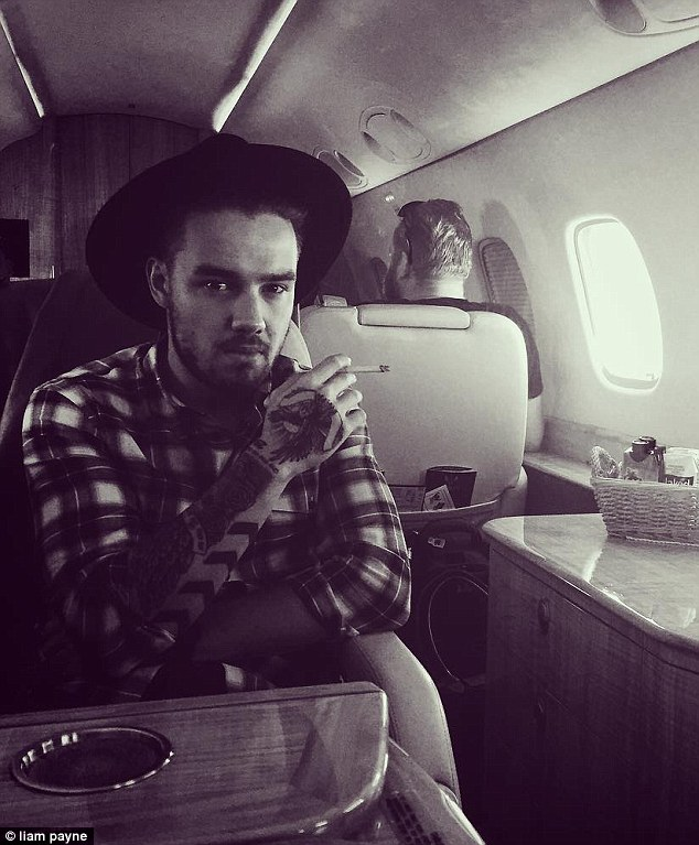 Left fans fuming: Liam Payne is keen to break away from his golden boy of pop reputation with his latest Instagram post, which showed him smoking a cigarette aboard a private jet