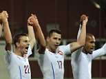Czech Republic's team players celebrates after the Euro 2016 qualifying Group A soccer match between Latvia and  Czech Republic in Riga, Latvia, Sunday, Sept. 6, 2015. (AP Photo/Roman Koksarov)