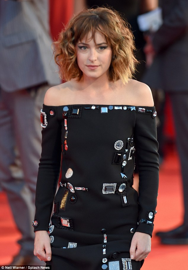 Dazzling: Dakota's artistic dress no doubt made her a magnet for attention