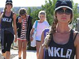 Denise Richards takes daughters Sam and Lola to the Malibu fair to ride rides and play games on Saturday, September 5, 2015. X17online.com