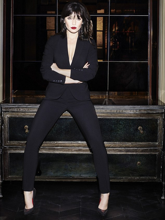 Posing braless in a sharply cut black blazer jacket and slim fit black trousers Daisy flaunts her famous curves in the campaign.Other shots see her wowing in a classic LBD, a printed tunic dress and a plunging grey gown