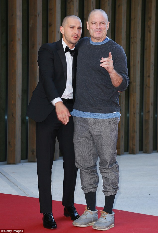 Chums: Man Down director Dito Montiel threw an arm around the leading star while donning a rather casual outfit