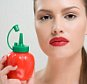 Woman holding a bottle of tomato ketchup