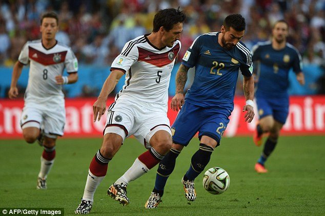Keeping an eye on him: Hummels (No 5)  tries not to let Ezequiel Lavezzi get away from him