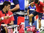 Novak Djokovic of Serbia puts his racket away after stomping on it while playing Roberto Bautista Agut from Spain during their US Open 2015 fourth round men's singles match at the USTA Billie Jean King National Tennis Center on September 6, 2015  in New York. AFP PHOTO/DON EMMERTDON EMMERT/AFP/Getty Images