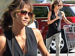 **EXCLUSIVE**     Date: September 4th 2015      Photo Credit: MOVI Inc.\nOnly Halle Berry can make grocery shopping looks this good. The stunning actress,49, looked flawless in shiny gold leather pants, high heels and a flowing black blouse as the mother of two picked up her weekly groceries at her local supermarket in Beverly Hills,Ca. \n