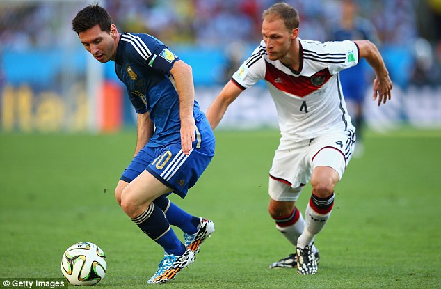 Big player on the big stage: Messi shields the ball from Germany full back Hoewedes