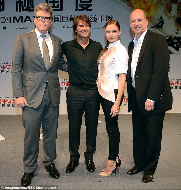 Group shot: Tom and Rebecca were later joined by director Christopher McQuarrie (left), who was looking super smart in a grey suit and white shirt