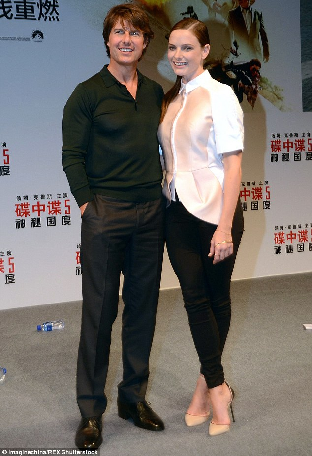 Allies: Tom, who plays senior field operations agent Ethan Hunt in the Mission Impossible movies, was joined by co-star Rebecca Ferguson, 31,as they attended a photo call at the Shanghai Film Centre
