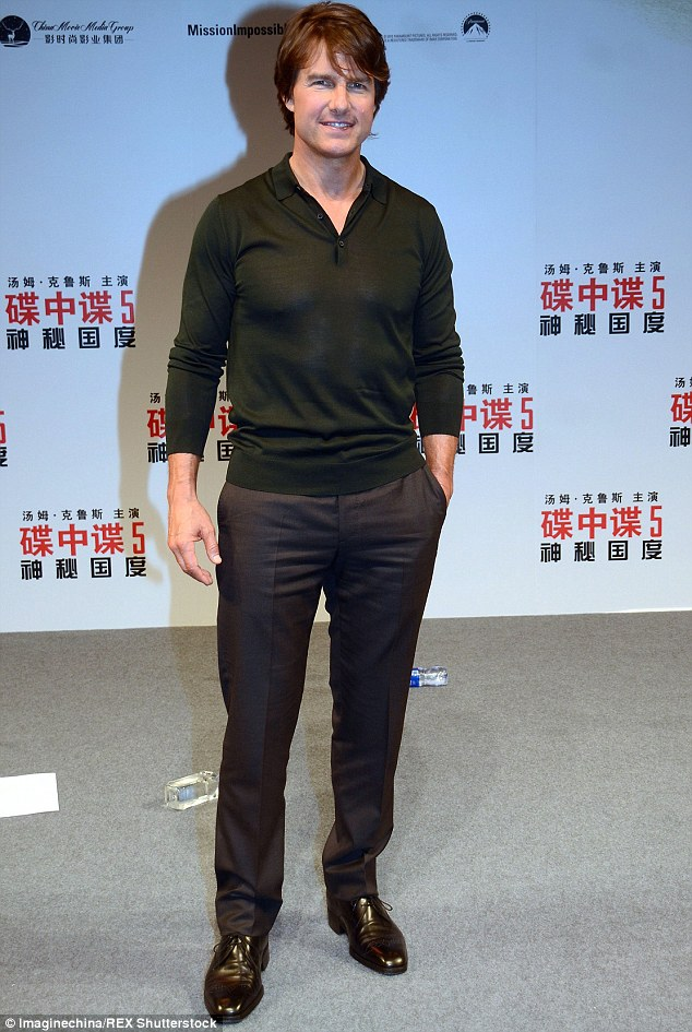 Still going: Tom Cruise, 53, was busy promoting Mission: Impossible - Rogue Nation in China on Sunday ahead of the film's release on Tuesday
