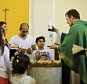 Pastor Gottfried Martens lights a candle during a service to baptize people from Iran, in the Trinity Church in Berlin, Aug. 30, 2015. Third right is Iranian asylum-seeker Mohammed Ali Zanoobi. He is one of hundreds of mostly Iranian and Afghan asylum seekers who have converted to Christianity at the evangelical Trinity Church in the leafy Berlin neighborhood. Most say true belief prompted their embrace of Christianity, but thereís no overlooking the fact that the decision will also greatly boost their chances of winning asylum by allowing them to claim they would face persecution if sent home. (AP Photo/Markus Schreiber)