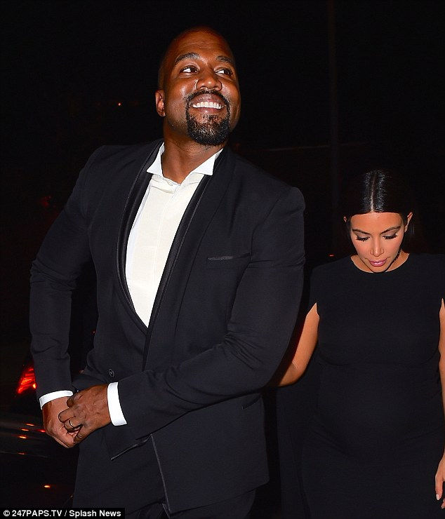 Good vibes: Kanye, who is known for his stone-face expressions, couldn't help but show off his pearly whites all night while in Tarrytown, also displaying his bright gold wedding band