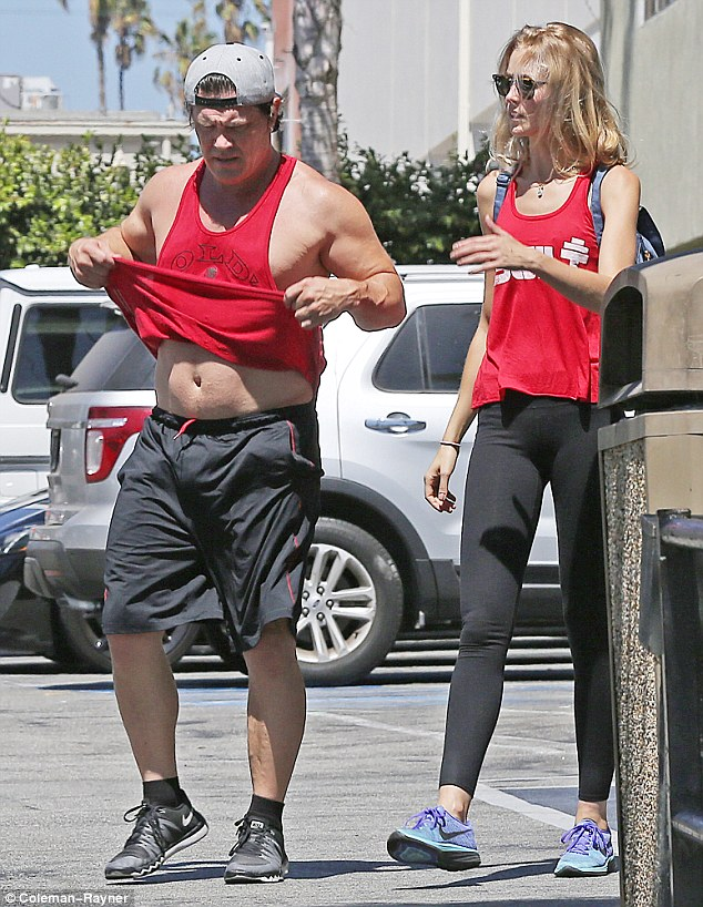 Working on his fitness! Josh Brolin showed off his abs as he went to wipe off his brow following a gym session on Sunday withfiancée Kathryn Boyd